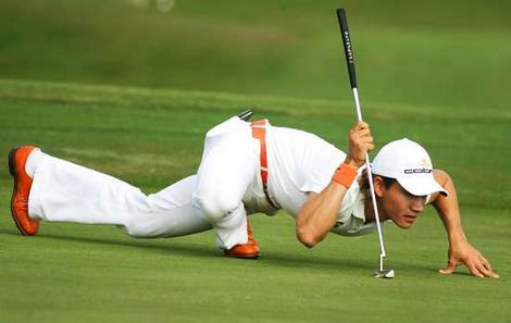 Camillo Villegas Reading a Putt. You don't have to do it like him but make it a habit to examine the green before you putt.