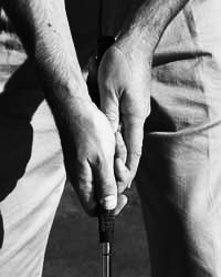 Classical putting grip.