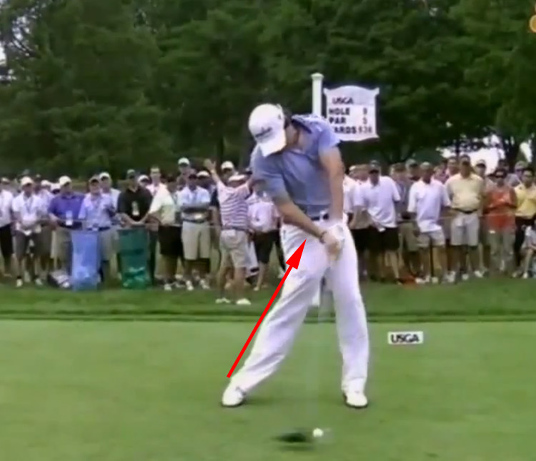 At impact Rory McIlroy straightens his right leg.