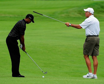 Tiger Woods working on his alignment,