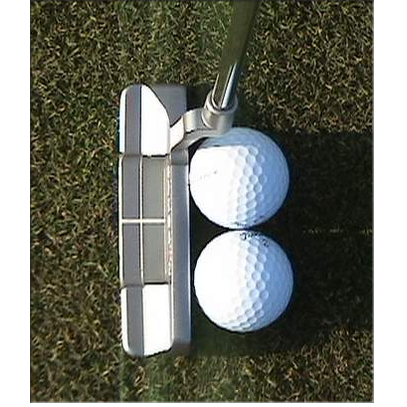 Putting two golf balls can help to work on your club face angle.