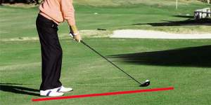 Find an upward slope on the practice tee to swing more from the inside.