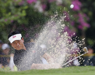 K.J. Choi splashing it out of the bunker.