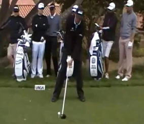 Phil Mickelson setting up to hit a big drive.
