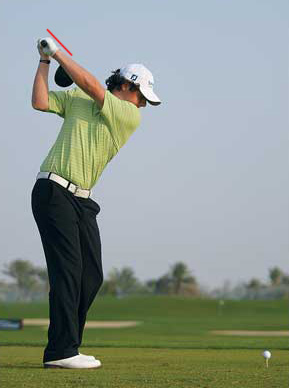 Rory McIlroy at the top of his backswing.